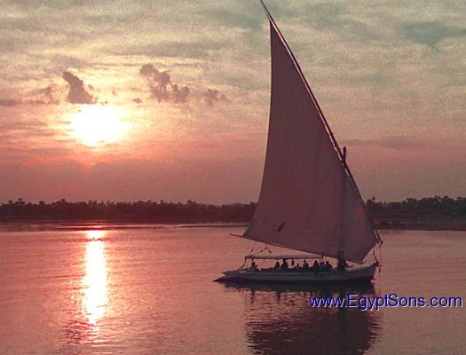 A Felucca full of people at sunset